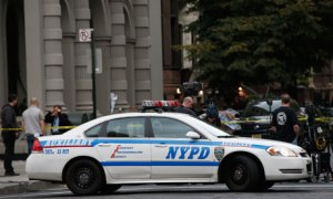 NYPD cars outside the apartment