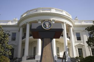 USA, Washington DC, Presidential Seal on podium in front of The White House, low angle view