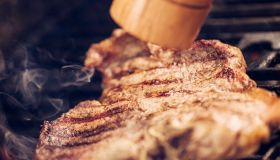 Roasting T-Bone Steak on Barbecue Grill