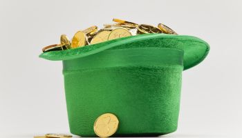 Green hat filled with golden coins