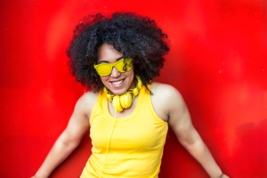 Woman in yellow vest,headphones and sunglasses