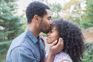 Young couple embraces and kisses outside