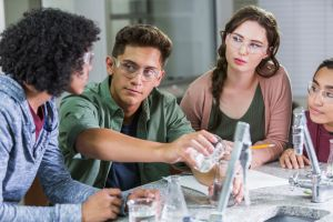 High school students doing chemistry lab experiment