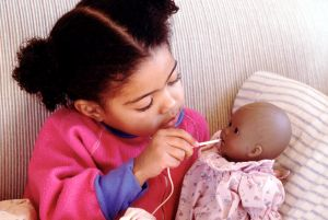 Child caring for sick doll