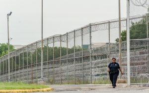 Stephen Moyer, Secretary of the Maryland Dept of Public Safety and Correctional Services, tours the Correctional Institution for Women with the warden, Margaret Chippendale.