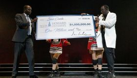 Sean 'Diddy' Combs Presents Howard University President Wayne A.I. Frederick With Special Donation Check