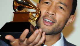 John Legend poses with his awards during