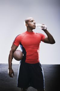 Football player drinking bottled water
