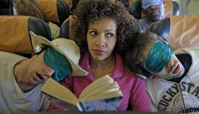 Black woman on an airplane