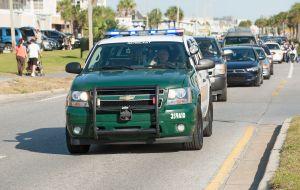 Sergeants car of the Sheriffs Department driving on a blue light Florida USA