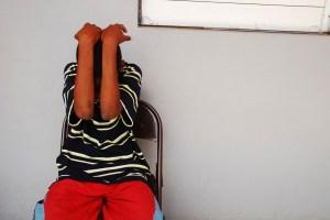 Dominica, Roseau, Juveniles Prison social center, teenager hiding his face