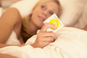 Teen girl holding condom