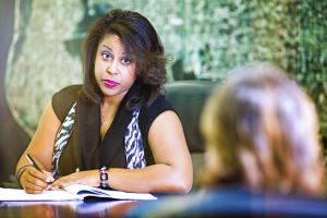 Unimpressed HR woman filing a complaint