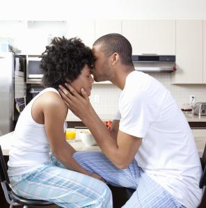 Couple kissing in kitchen