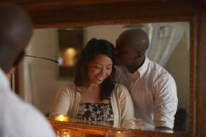Young man kissing woman reflection in mirror
