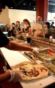 Amina Gunn Assembles A Chicken Queso Burrito At Qdoba