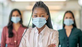 The business women wearing masks