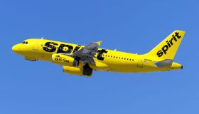 A Spirit Airlines Airbus 319 takes off from Los Angeles at...