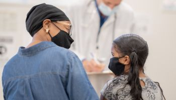 Wearing A Mask at the Paediatrician Office Stock Photo
