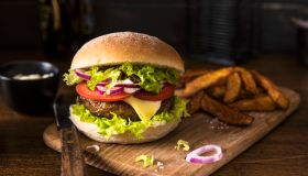 Cheeseburger with tomatoes, onion and lettuce