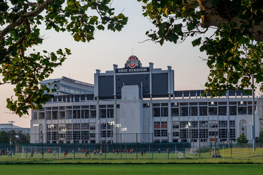 Students play soccer with the Ohio Stadium in the background...
