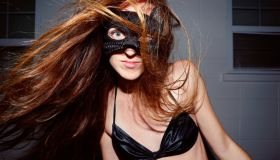Hair Toss: Mysterious woman with long hair wearing cat mask disguise
